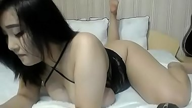 Asian slut teasing nice body on cam