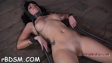 Gagged angel with legs widen wide receives toy pleasuring