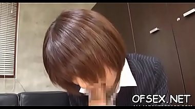 Irresistable chick teases a horny lad in the office