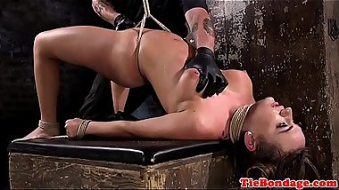 Busty bondage submissive gets flogged