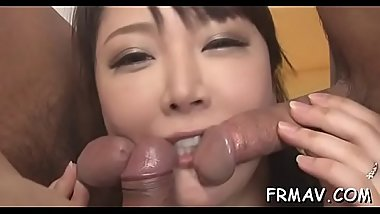 Charming asian enjoys coarse fingering during three-some