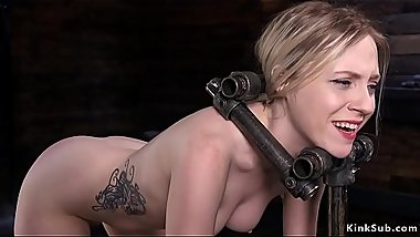 Blonde in metal device hot ass spanked