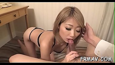 Gorgeous japanese tackles a palpitating one-eyed monster with her mouth
